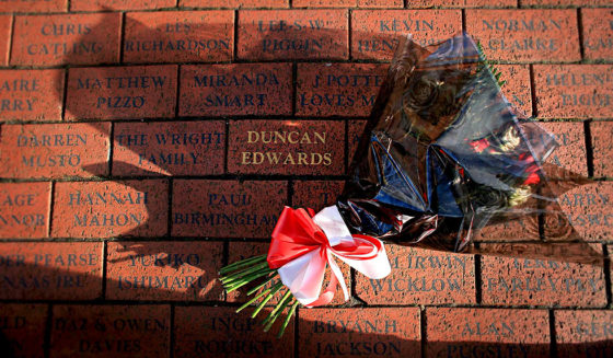 MANCHESTER, UNITED KINGDOM - FEBRUARY 06: A bouquet of flowers lays next to a memorial stone to 'Busby Babe' Duncan Edwards, one of the victims of the the Munich disaster. February 6, 2008,Manchester, England. The club will be holding memorial events later to remember the 23 people who died in an airplane crash at Munich Airport 50 years ago. Eight Manchester United players were among the dead. (Photo by Christopher Furlong/Getty Images)