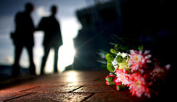MANCHESTER, UNITED KINGDOM - FEBRUARY 06:  A bouquet of flowers lays next to a memorial stone to 'Busby Babe' Duncan Edwards, one of the victims of the the Munich disaster, as manchester United fans take part in a minutes silence on  February 6, 2008, Manchester, England. The club will be holding memorial events later to remember the 23 people who died in an airplane crash at Munich Airport 50 years ago. Eight Manchester United players were among the dead.  (Photo by Christopher Furlong/Getty Images)