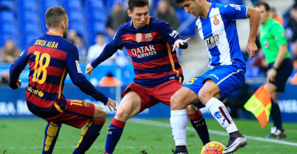 RCD Espanyol's Spanish midfielder Marco Asensio (R) vies with Barcelona's Argentinian forward Lionel Messi (C) during the Spanish league football match RCD Espanyol vs FC Barcelona at the Power8 stadium in Cornella de Llobregat on January 2, 2016. AFP PHOTO/ PAU BARRENA / AFP / PAU BARRENA (Photo credit should read PAU BARRENA/AFP/Getty Images)