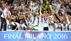 Real Madrid's Spanish defender Sergio Ramos (C) lifts the trophy as Real Madrid players celebrate winning the UEFA Champions League final football match over Atletico Madrid at San Siro Stadium in Milan, on May 28, 2016. / AFP / GERARD JULIEN        (Photo credit should read GERARD JULIEN/AFP/Getty Images)
