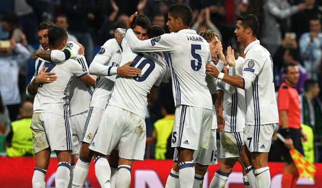 Real Madrid's forward Alvaro Morata is congratulated by his teammates after scoring during the UEFA Champions League football match Real Madrid CF vs Sporting CP at the Santiago Bernabeu stadium in Madrid on September 14, 2016. Real Madrid won 2-1. / AFP / GERARD JULIEN        (Photo credit should read GERARD JULIEN/AFP/Getty Images)