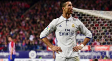 Real Madrid's Portuguese forward Cristiano Ronaldo celebrates after scoring his third goal during the Spanish league football match Club Atletico de Madrid vs Real Madrid CF at the Vicente Calderon stadium in Madrid, on November 19, 2016. / AFP / GERARD JULIEN        (Photo credit should read GERARD JULIEN/AFP/Getty Images)