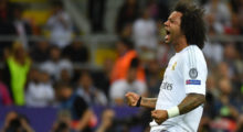 Real Madrid's Brazilian defender Marcelo celebrates after Real Madrid won the UEFA Champions League final football match over Atletico Madrid at San Siro Stadium in Milan, on May 28, 2016. / AFP / GERARD JULIEN        (Photo credit should read GERARD JULIEN/AFP/Getty Images)