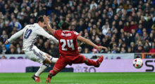 Real Madrid's Colombian midfielder James Rodriguez (L) kicks a ball to score past Sevilla's Argentinian defender Gabriel Mercado during the Spanish Copa del Rey (King's Cup) round of 16 first leg football match Real Madrid CF vs Sevilla FC at the Santiago Bernabeu stadium in Madrid on January 4, 2017. / AFP / GERARD JULIEN        (Photo credit should read GERARD JULIEN/AFP/Getty Images)