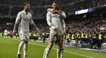 Real Madrid's Portuguese forward Cristiano Ronaldo (C) is congratulated by Real Madrid's defender Sergio Ramos (L) and Real Madrid's Brazilian midfielder Casemiro after scoring a goal during the Spanish league football match Real Madrid CF vs Real Sociedad at the Santiago Bernabeu stadium in Madrid on January 29, 2017. / AFP / GERARD JULIEN        (Photo credit should read GERARD JULIEN/AFP/Getty Images)