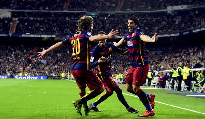 "Barcelona's Uruguayan forward Luis Suarez (R) celebrates a goal with teammates during the Spanish league ""Clasico"" football match Real Madrid CF vs FC Barcelona at the Santiago Bernabeu stadium in Madrid on November 21, 2015. AFP PHOTO/ JAVIER SORIANO (Photo credit should read JAVIER SORIANO/AFP/Getty Images)"