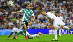 Real Madrid's French forward Karim Benzema (R) heads the ball to score during the Spanish league football match Real Madrid CF vs Real Betis Balompie at the Santiago Bernabeu stadium in Madrid on August 29, 2015.   AFP PHOTO/ PIERRE-PHILIPPE MARCOU        (Photo credit should read PIERRE-PHILIPPE MARCOU/AFP/Getty Images)