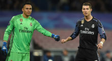 Real Madrid's Costa Rican goalkeeper Keylor Navas and Real Madrid's Portuguese forward Cristiano Ronaldo (R) during the UEFA Champions League football match SSC Napoli vs Real Madrid on March 7, 2017 at the San Paolo stadium in Naples. / AFP PHOTO / Filippo MONTEFORTE        (Photo credit should read FILIPPO MONTEFORTE/AFP/Getty Images)