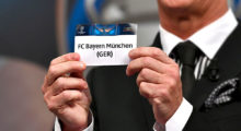 Liverpool football legend and UEFA Champions League Final Ambassador Ian Rush shows a piece of paper bearing the name of FC Bayern Munchen during the quarter-final draw for the UEFA Champions League football tournament at the UEFA headquarters in Nyon on December 17, 2017. / AFP PHOTO / Fabrice COFFRINI        (Photo credit should read FABRICE COFFRINI/AFP/Getty Images)