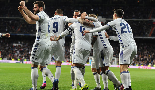 MADRID, SPAIN - MARCH 12: Sergio Ramos of Real Madrid celebrates with teammates after scoring Real's 2nd goal during the La Liga match between Real Madrid CF and Real Betis Balompie at Estadio Santiago Bernabeu on March 12, 2017 in Madrid, Spain. (Photo by Denis Doyle/Getty Images)