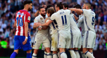 Atletico Madrid's Belgian forward Yannick Ferreira Carrasco (L) walks past Real Madrid players celebrating their opening goal during the Spanish league football match Real Madrid CF vs Club Atletico de Madrid at the Santiago Bernabeu stadium in Madrid on April, 8, 2017. / AFP PHOTO / GERARD JULIEN        (Photo credit should read GERARD JULIEN/AFP/Getty Images)
