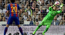 Real Madrid's Costa Rican goalkeeper Keylor Navas secures a ball during the Spanish league football match Real Madrid CF vs FC Barcelona at the Santiago Bernabeu stadium in Madrid on April 23, 2017. / AFP PHOTO / PIERRE-PHILIPPE MARCOU        (Photo credit should read PIERRE-PHILIPPE MARCOU/AFP/Getty Images)
