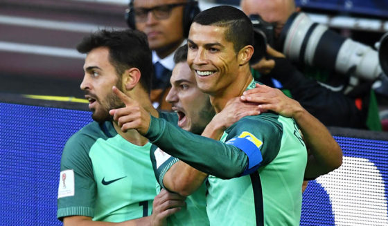 Portugal's forward Cristiano Ronaldo (R) celebrates after scoring a goal during the 2017 Confederations Cup group A football match between Russia and Portugal at the Spartak Stadium in Moscow on June 21, 2017. / AFP PHOTO / Yuri KADOBNOV (Photo credit should read YURI KADOBNOV/AFP/Getty Images)