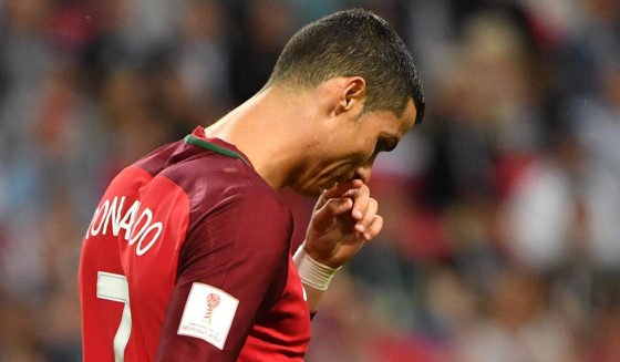 Portugal's forward Cristiano Ronaldo reacts during the 2017 Confederations Cup semi-final football match between Portugal and Chile at the Kazan Arena in Kazan on June 28, 2017. / AFP PHOTO / Yuri CORTEZ (Photo credit should read YURI CORTEZ/AFP/Getty Images)