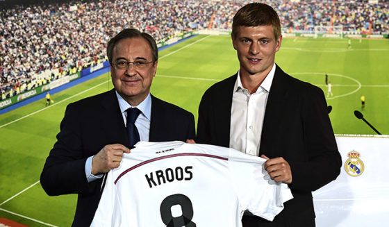 New Real Madrid's German midifielder Toni Kroos (R) poses with his new team's jersey past Real Madrid's President Florentino Perez during his presentation at the Santiago Bernabeu stadium in Madrid July 17, 2014. World Cup winner Toni Kroos became today Real Madrid's first high profile signing for the new season, moving from Bayern Munich on a six-year deal just days after winning the World Cup with Germany. AFP PHOTO/ JAVIER SORIANO (Photo credit should read JAVIER SORIANO/AFP/Getty Images)