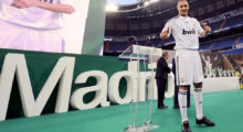 Real Madrid's new football player French Karim Benzema waves to supporters during his official presentation at the Santiago Bernabeu stadium in Madrid on July 9, 2009. Benzema, who has been compared to former French international and Real star Zinedine Zidane, was the first new player who Real president Florentino Perez signed after he returned to the helm of the club in June.   AFP PHOTO / PIERRE-PHILIPPE MARCOU (Photo credit should read PIERRE-PHILIPPE MARCOU/AFP/Getty Images)