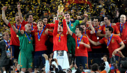 Spain's defender Sergio Ramos (C) raises the trophy as Spain's national football team players celebrate winning the 2010 World Cup football final Netherlands vs. Spain on July 11, 2010 at Soccer City stadium in Soweto, suburban Johannesburg. NO PUSH TO MOBILE / MOBILE USE SOLELY WITHIN EDITORIAL ARTICLE -      AFP PHOTO / GABRIEL BOUYS (Photo credit should read GABRIEL BOUYS/AFP/Getty Images)