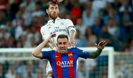 MADRID, SPAIN - APRIL 23: Sergio Ramos of Real Madrid outjumps Paco Alcacer of Barcelona during the La Liga match between Real Madrid CF and FC Barcelona at Estadio Bernabeu on April 23, 2017 in Madrid, Spain. (Photo by Gonzalo Arroyo Moreno/Getty Images)