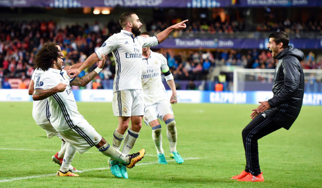 Real Madrid's Spanish defender Dani Carvajal (C) celebrates with his teammates after scoring the 3-2 goal at overtime during the UEFA Super Cup final football match between Real Madrid CF and Sevilla FC on August 9, 2016 at the Lerkendal Stadion in Trondheim. Real Madrid won 3-2. / AFP / JONATHAN NACKSTRAND (Photo credit should read JONATHAN NACKSTRAND/AFP/Getty Images)