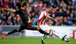 STOKE ON TRENT, ENGLAND - AUGUST 19:  Jese of Stoke City scores his sides first goal as Nacho Monreal of Arsenal attempts to block during the Premier League match between Stoke City and Arsenal at Bet365 Stadium on August 19, 2017 in Stoke on Trent, England.  (Photo by Alex Livesey/Getty Images)