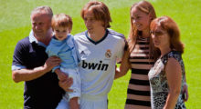 MADRID, SPAIN - AUGUST 27:  Luka Modric holds his son and poses with his wife Vanja Bosnic and his parents during Luka's presentation as a new Real Madrid player at Estadio Santiago Bernabeu on August 27, 2012 in Madrid, Spain.  (Photo by Gonzalo Arroyo Moreno/Getty Images)