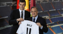 New Welsh striker Gareth Bale of Real Madrid (L) poses with his new jersey next to Real Madrid's President Florentino Perez during his presentation at the Santiago Bernabeu stadium in Madrid on September 2, 2013. Bale was unveiled as a Real Madrid player today after his prolonged transfer from Tottenham Hotspur was finally completed for an unconfirmed world record fee late September 1. The Welshman has agreed a six-year deal believed to be worth 10 million euros net a year and will be presented to the media and the club's fans after undergoing a medical in the Spanish capital.   AFP PHOTO/ PIERRE-PHILIPPE MARCOU        (Photo credit should read PIERRE-PHILIPPE MARCOU/AFP/Getty Images)