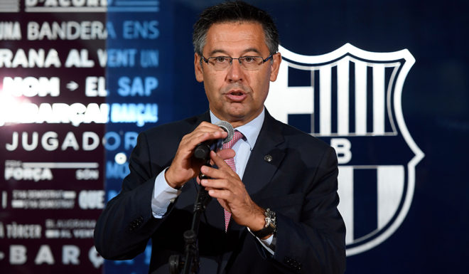 Barcelona's president Josep Maria Bartomeu speaks during the official presentation of Barcelona's new Brazilian football player Paulinho Bezerra, after signing his new contract with the Catalan club at the Camp Nou stadium in Barcelona on August 17, 2017. / AFP PHOTO / LLUIS GENE (Photo credit should read LLUIS GENE/AFP/Getty Images)