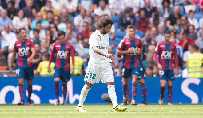 MADRID, SPAIN - SEPTEMBER 09: Marcelo of Real Madrid CF reacts after Levante scored their opening goal during the La Liga match between Real Madrid and Levante at Estadio Santiago Bernabeu on September 9, 2017 in Madrid, . (Photo by Denis Doyle/Getty Ima