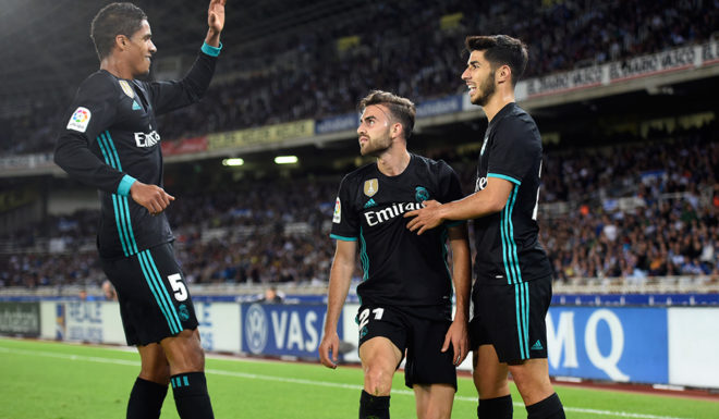 Real Madrid's forward from Spain Borja Mayoral (C) is congratulated by teammates Real Madrid's defender from France Raphael Varane (L) and Real Madrid's midfielder from Spain Marco Asensio after scoring the opening goal during the Spanish league football match Real Sociedad vs Real Madrid CF at the Anoeta stadium in San Sebastian on September 17, 2017. / AFP PHOTO / ANDER GILLENEA (Photo credit should read ANDER GILLENEA/AFP/Getty Images)