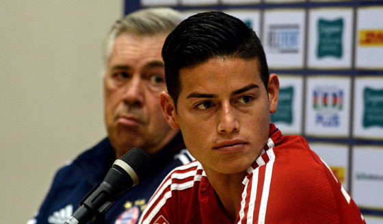 Bayern Munich's midfielder James Rodriguez (R) and head coach Carlo Ancelotti attend a pre-match press conference in Singapore on July 24, 2017, ahead of the International Champions Cup football match between Bayern Munich and Chelsea on July 25. / AFP PHOTO / ROSLAN RAHMAN (Photo credit should read ROSLAN RAHMAN/AFP/Getty Images)