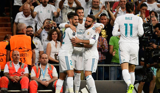 Real Madrid's forward from Portugal Cristiano Ronaldo (C) celebrates with teammates after scoring during the UEFA Champions League football match Real Madrid CF vs APOEL FC at the Santiago Bernabeu stadium in Madrid on September 13, 2017. / AFP PHOTO / PIERRE-PHILIPPE MARCOU (Photo credit should read PIERRE-PHILIPPE MARCOU/AFP/Getty Images)