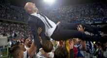 Real Madrid's French head coach Zinedine Zidane is tossed by players at the end of the Spanish league football match Malaga CF vs Real Madrid at La Rosaleda stadium in Malaga on May 21, 2017. Real Madrid won their 33rd La Liga title and first for five years as Cristiano Ronaldo's 40th goal of the season helped seal a 2-0 win at Malaga today.   / AFP PHOTO / SERGIO CAMACHO        (Photo credit should read SERGIO CAMACHO/AFP/Getty Images)
