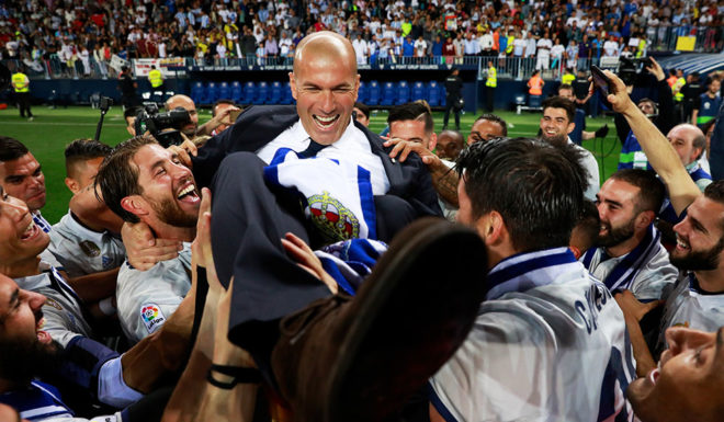 MALAGA, SPAIN - MAY 21: Zinedine Zidane, Manager of Real Madrid celebrates with his players after being crowned champions following the La Liga match between Malaga and Real Madrid at La Rosaleda Stadium on May 21, 2017 in Malaga, Spain. (Photo by Gonzalo Arroyo Moreno/Getty Images)