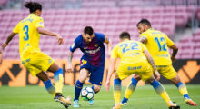 BARCELONA, SPAIN - OCTOBER 01: Lionel Messi of FC Barcelona conducts the ball between Pablo Lemos (L), Ximo Navarro (2nd R) and Michel Macedo (R) of UD Las Palmas during the La Liga match between Barcelona and Las Palmas at Camp Nou on October 1, 2017 in Barcelona, Spain. The match is being played with empty stands after the events occured in Catalonia during the voting of a Catalonia independence referendum declared illegal and undemocratic by the Spanish government. (Photo by Alex Caparros/Getty Images)