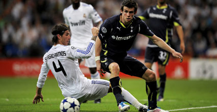 MADRID, SPAIN - APRIL 05:  Gareth Bale of Tottenham Hotspur (R) fights for the ball against Sergio Ramos of Real Madrid during the UEFA Champions League quarter final first leg match between Real Madrid and Tottenham Hotspur at Estadio Santiago Bernabeu on April 5, 2011 in Madrid, Spain. Real Madrid won 4-0.  (Photo by David Ramos/Getty Images)