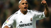 Madrid, SPAIN:  Real Madrid Roberto Carlos (R) reacts after his goal during the Spanish league football match against Zaragoza at the Santiago Bernabeu stadium in Madrid, 06 november 2005                  AFP PHOTO/PHILIPPE DESMAZES  (Photo credit should read PHILIPPE DESMAZES/AFP/Getty Images)