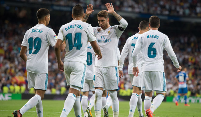 MADRID, SPAIN - OCTOBER 01: Sergio Ramos of Real Madrid celebrates with teammates after Isco Alarcon of scored their teamÕs opening goal during the La Liga match between Real Madrid and Espanyol at Estadio Santiago Bernabeu on October 1, 2017 in Madrid, Spain. (Photo by Denis Doyle/Getty Images)