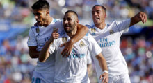 Real Madrid's French forward Karim Benzema (C) celebrates with Real Madrid's Spanish midfielders Marco Asensio (L) and Lucas Vazquez (R) after scoring a goal during the Spanish league football match Getafe CF vs Real Madrid at the Coliseum Alfonso Perez stadium in Getafe on October 14, 2017. / AFP PHOTO / OSCAR DEL POZO        (Photo credit should read OSCAR DEL POZO/AFP/Getty Images)