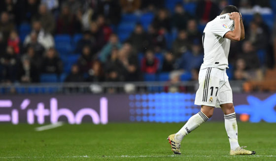 Spanish midfielder Lukas Vasquez of Real Madrid leaves the ground in the Spanish League Real Madrid CF and Real Soccer on January 6, 2019 at the Santiago Bernabe stadium in Madrid. (Photo by Gabriel Boise / AFP) (Photo credit should read Gabriel Bose / AFP / Getty Images)