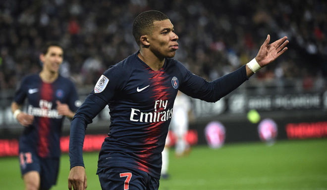 Paris Saint-Germain's French forward Kylian Mbappe celebrates scoring during the French Football match between Amiens and Paris on January 12, 2019 at the Licorne stadium in Amiens. (Photo by FRANCOIS LO PRESTI / AFP) (Photo credit should read FRANCOIS LO PRESTI / AFP / Getty Images)