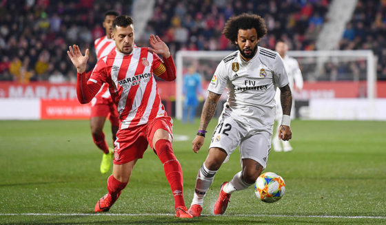 GIRONA, SPAIN - January 31: Alex Granell de Girona and Marcelo Real Madrid in action during the Copa del Cuartel final between Girona and Real Madrid at the Montilivi Stadium on January 31, 2019 in Girona. (Photo by David Ramos / Getty Images)