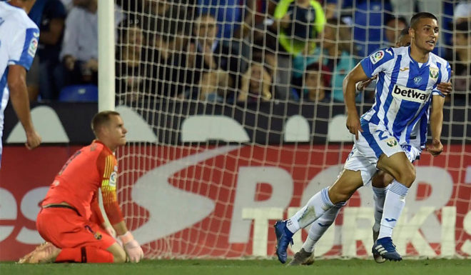 """Legane's Spanish midfielder Oscar Rodriguez (R) celebrates points for his team's second goal during the Spanish league football game Deportivo Leganes SAD against FC Barcelona in the Estadio Municipal Butarque in Leganes on the outskirts of Madrid on September 26, 201<div class=""""e3lan e3lan-in-post1""""><script async src=""""//pagead2.googlesyndication.com/pagead/js/adsbygoogle.js""""></script> <!-- Text_Display_Ad --> <ins class=""""adsbygoogle""""      style=""""display:block""""      data-ad-client=""""ca-pub-7542518979287585""""      data-ad-slot=""""2196042218""""      data-ad-format=""""auto""""></ins> <script> (adsbygoogle = window.adsbygoogle 