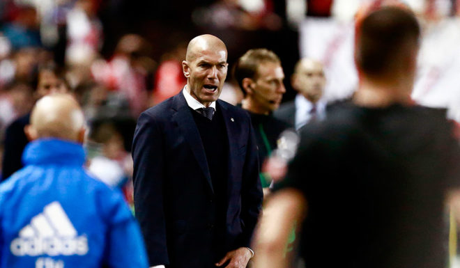 Real Madrid's French coach Zinedine Zidane reacts during the soccer match between Rayo Vallecano and Real Madrid at the Vallecas Stadium in Puente de Vallecas on April 28, 2019. (Photo credit BENJAMIN CREMEL / AFP) BENJAMIN CREMEL / AFP / Getty Images)