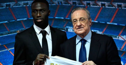 French defender Ferland Mendy (L) and Real Madrid's president Florentino Perez form the official presentation of the football player as a new player in the Spanish Club at the Santiago Bernabeu Stadium in Madrid on June 19, 2019. (Photo by OSCAR DEL POZO / AFP) (Photo Credit to read OSCAR DEL POZO / AFP / Getty Images)