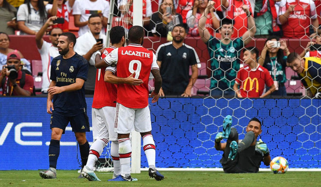 French striker Arsenal, Alexandre Lakazet, celebrates after scoring a goal against the Costa Rican goalkeeper goalkeeper, Nevada's realtor during the International Champions Cup football match between Real Madrid and FedEx Field in Landover, Maryland on July 23, 2019. (Photo by Jim WATSON / AFP) (credit photo JIM WATSON / AFP / Getty Images)