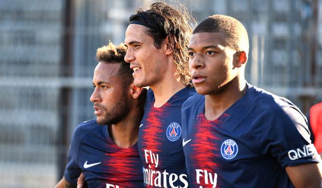 "Paris Saint-Germain's French forward Kylian Mbappe (R) celebrates with Paris Saint-Germain's Uruguayan forward Edinson Cavani (C) and Paris Saint-Germain's Nimes and Paris Saint-Germain (PSG), on September 1<div class=""e3lan e3lan-in-post1""><script async src=""//pagead2.googlesyndication.com/pagead/js/adsbygoogle.js""></script> <!-- Text_Display_Ad --> <ins class=""adsbygoogle""      style=""display:block""      data-ad-client=""ca-pub-7542518979287585""      data-ad-slot=""2196042218""      data-ad-format=""auto""></ins> <script> (adsbygoogle = window.adsbygoogle    []).push({}); </script></div>, 2018 at the Costieres stadium in Nimes, southern France. Brazilian forward Neymar Jr (L) after scoring their third goal during the French L1 football match. (Photo credit: PASCAL GUYOT / AFP)"
